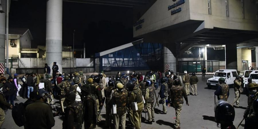 Police personnel conduct a march after the violent protests that erupted against Citizenship Amendment Act near Jamia Millia Islamia in New Delhi