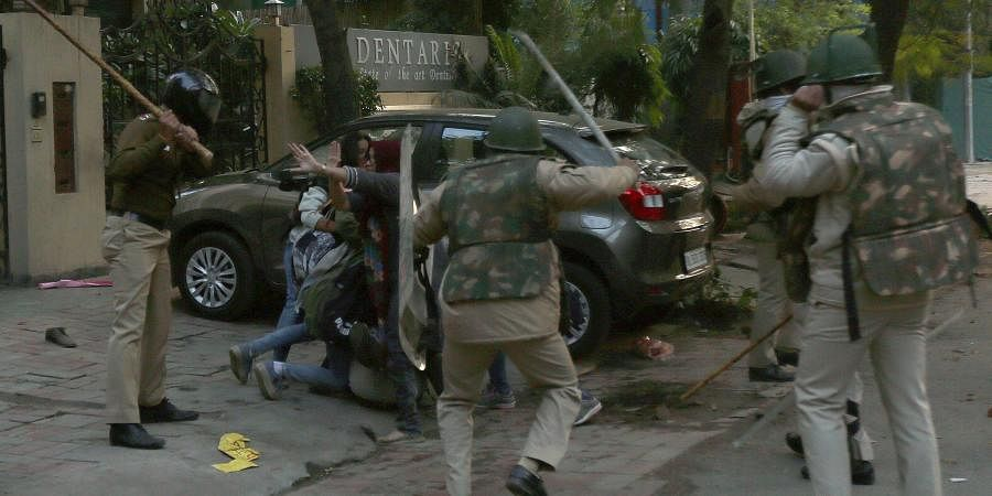 Unclaimed motorcycles, shards of broken window glasses, stones and footwear littered the roads near south Delhi's Jamia Millia Islamia university, which resembled a battle zone, after a protest against the amended citizenship law (Citizenship Act) on Sunday afternoon turned violent.