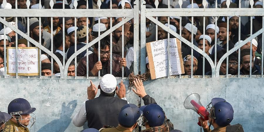 Lucknow Police force outside Darul Uloom Nadwatul Ulama college as students protest against the amended Citizenship Act and indulged in stone pelting.