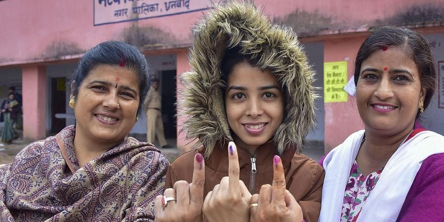 A first-time voter and her relatives show their inked finger after casting votes during the fourth phase of Jharkhand Assembly polls, in Dhanbad
