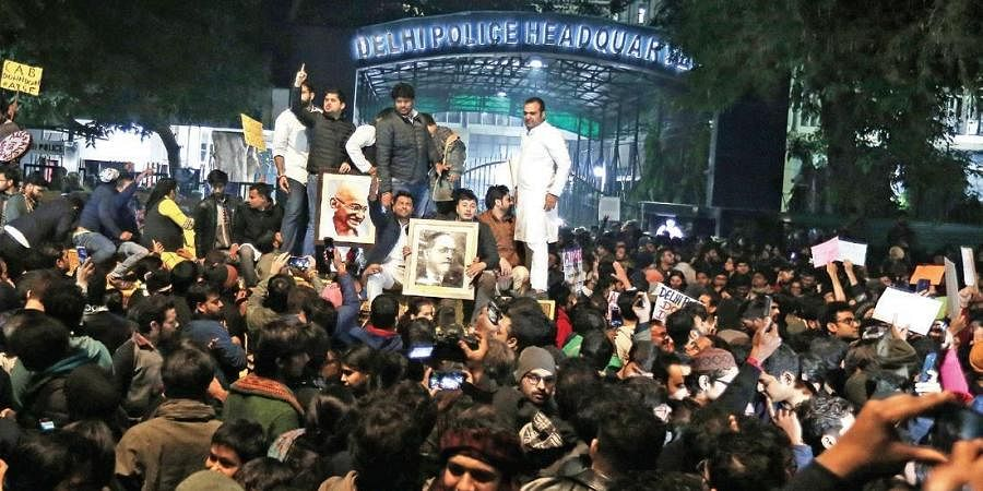 Students and others protest the police action against students of Jamia Millia Islamia. at PHQ on Sunday night