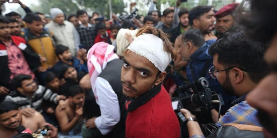 Defiant Jamia students a day after police charged into their campus