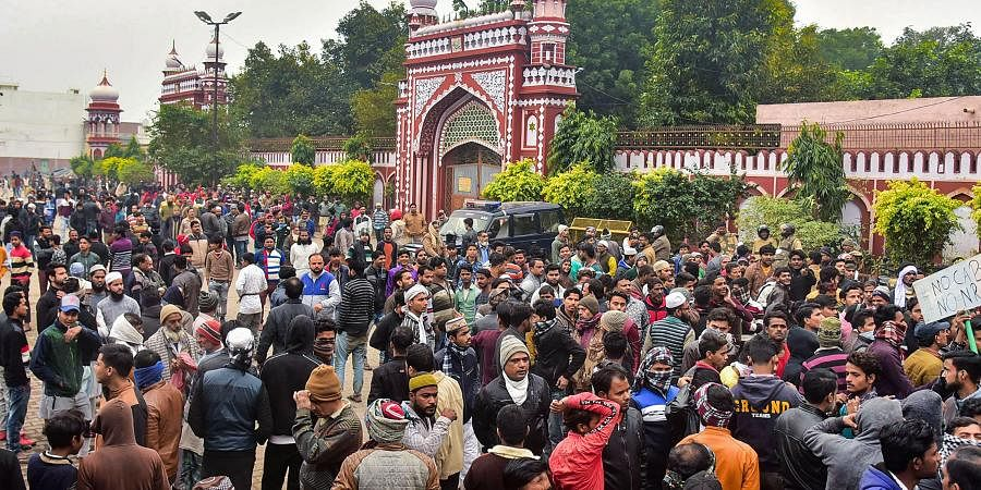 People gather at the Eidgah to protest against the alleged police action on AMU students who were protesting over Citizenship Amendment Act in Aligarh Monday
