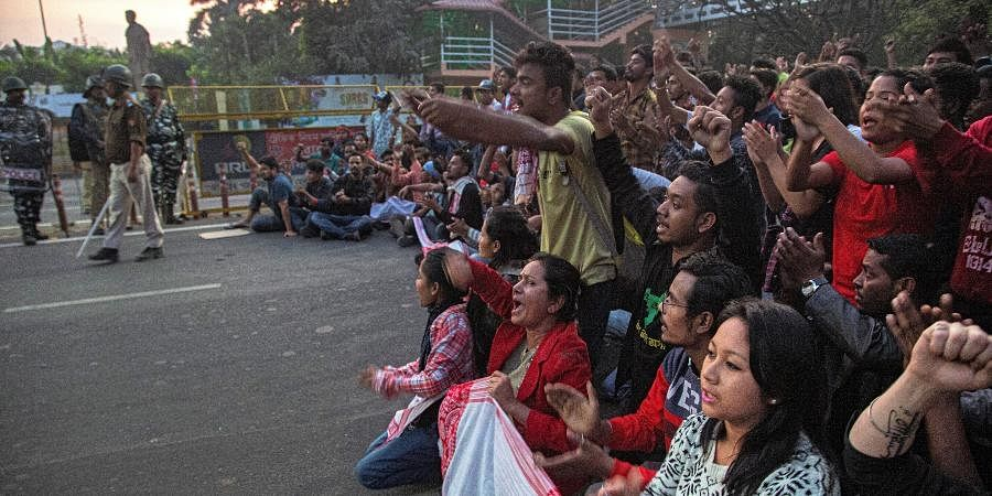 Protesters block a road during a curfew in Gauhati.