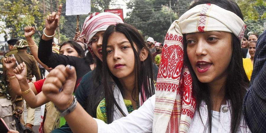 AASU supporters raise slogans during their Gana Saityagrah protest against Citizenship Amendment Act in Guwahati Dec. 16 2019. (Photo   PTI)