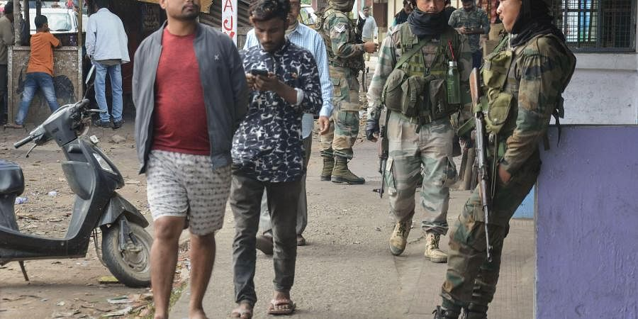 Army personnel guard in a market at Chauba which witnessed several an Anti-Citizenship Amendment Act protests in Dibrugarh district of Assam Tuesday