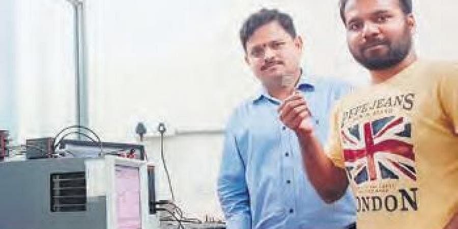 Suryanarayana Jammalamadaka and Dwipak Prasad Sahu showing the sensor to detect BSA