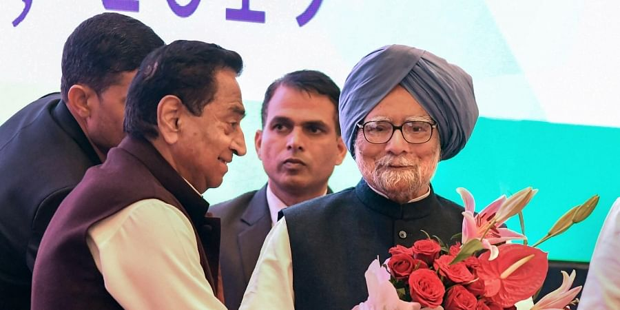 Former Prime Minister Manmohan Singh being welcomed by Madhya Pradesh Chief Minister Kamal Nath on his arrival to attend the Madhya Pradesh government's first anniversary celebrations in Bhopal Tuesday Dec. 17 2019.