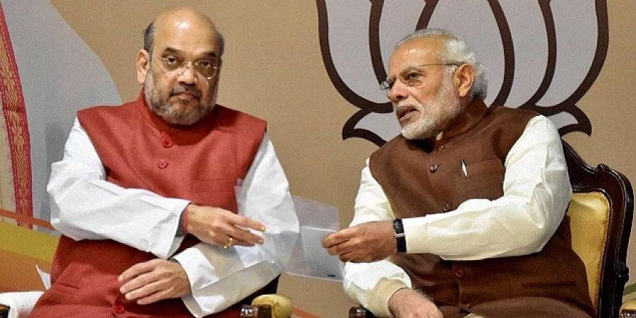 PM Narendra Modi (R) and Union Home Minister Amit Shah