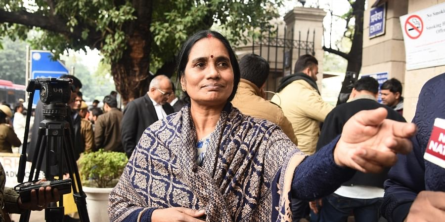 Nirbhaya's mother, who has been demanding death to four convicts, comes out of the Patiala House Courts Complex in New Delhi on Friday