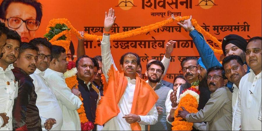 Maharashtra Chief Minister and Shiv Sena chief Uddhav Thackeray being garlanded by party wokers at a party meeting in Nagpur Monday Dec. 16 2019. (Photo | PTI)