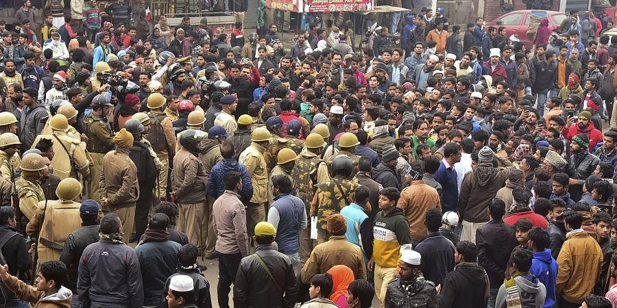 Police keep vigil as stuents along with local residents hold a protest against NRC and Citizenship Amendment Act in Dodhpur locality of Aligarh
