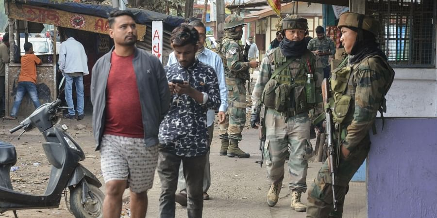 Army personnel guard in a market at Chauba which witnessed several an Anti-Citizenship Amendment Act protests in Dibrugarh district of Assam Tuesday Dec. 17 2019. (Photo | PTI)