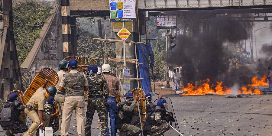 Police personnel attempt to disperse protestors during a demonstration against the passing of Citizenship Amendment Bill CAB at Santragachi in Howrah district of West Bengal Saturday Dec. 14 2019. (Photo | PTI)