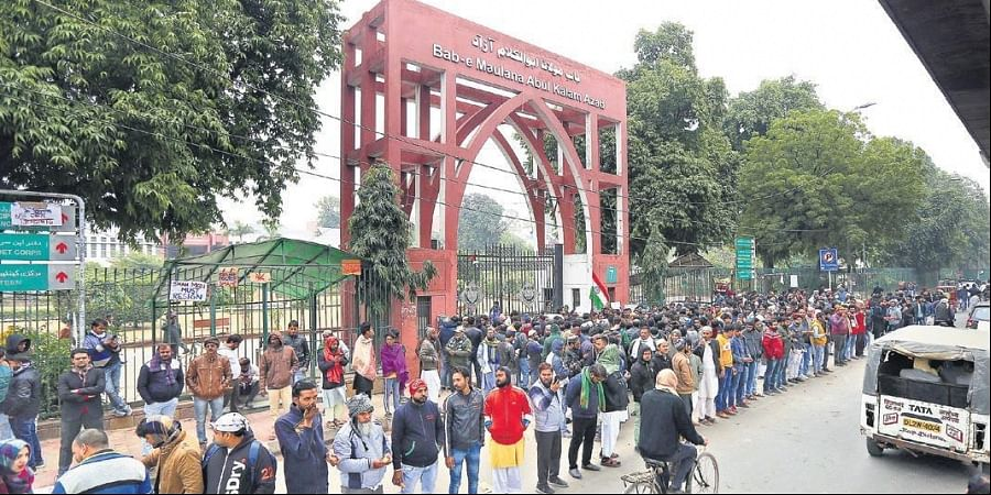 Protestors, including students and locals, during a demonstration outside Jamia Millia Islamia on Tuesday.
