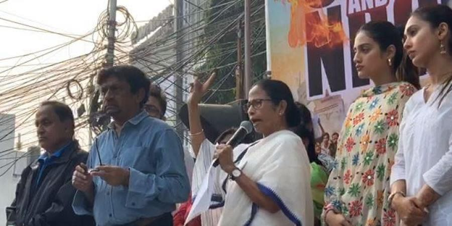 West Bengal CM and Trinamool Congress supremo Mamata Banerjee accompanied by party MPs Nusrat Jahan and Mimi Chakraborty, addresses during her party's '#NoCABNoNRC' protest march from Jadavpur to Bhowanipore