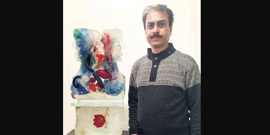 Artist and flimmaker Sisir Sahana; few of his glass sculptures from the show, A Dialogue with Soil