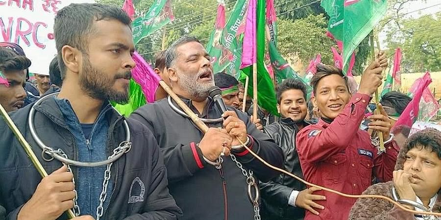 Chaining himself with iron rings to symbolisethe Constitution being caged by the Centre, Pappu Yadav, who is also an ex-MP, led a procession of his supporters throughthe main streets of Patna