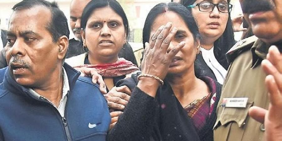 Nirbhaya's parents after a hearing at the Patiala House court in New Delhi on Wednesday .