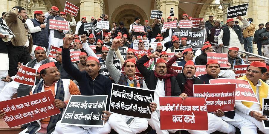 Samajwadi Party leaders protest against Citizenship Amendment Act (CAA) at Vidhan Sabha premises, in Lucknow