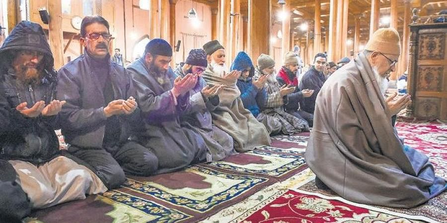 Head priest of the historic Jamia Masjid  leads Zuhr prayers inside the mosque in downtown Srinagar on Wednesday