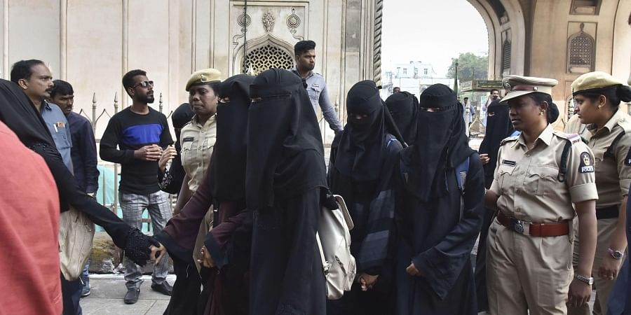 Protestors detained by police for defying prohibitory orders imposed in the area during an anti-Citizenship Act protest near Charminar, in Hyderabad, Thursday, Dec. 19, 2019