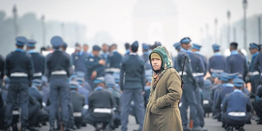 A soldier stands guard during rehearsals for the Republic Day parade at Rajpath on a bitterly cold Wednesday. The Met predicted a slightly warmer Thursday