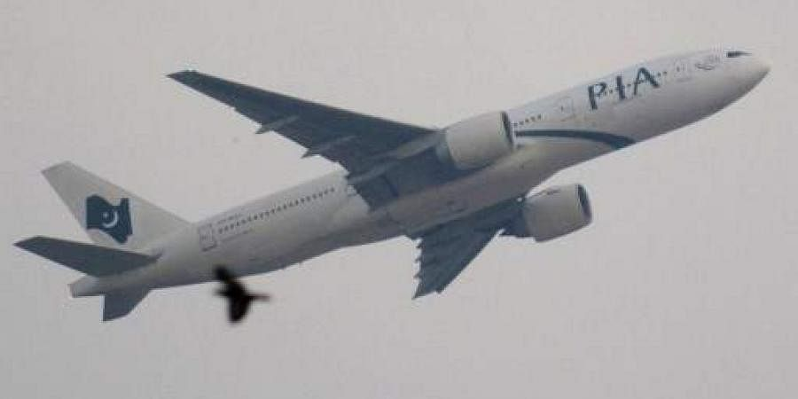 A Pakistan International Airlines (PIA) Boeing 777 aircraft takes off from Karachi airport