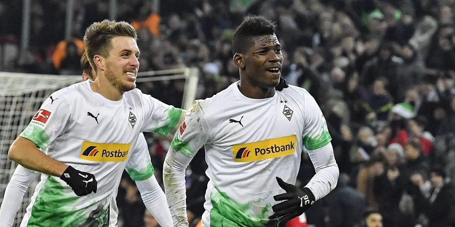 Moenchengladbach's Breel Embolo, right, celebrates his second goal with Patrick Herrmann during the German Bundesliga soccer match between Borussia Moenchengladbach and SC Freiburg in Moenchengladbach, Germany, Sunday, Dec. 1, 2019. (Photo | AP)