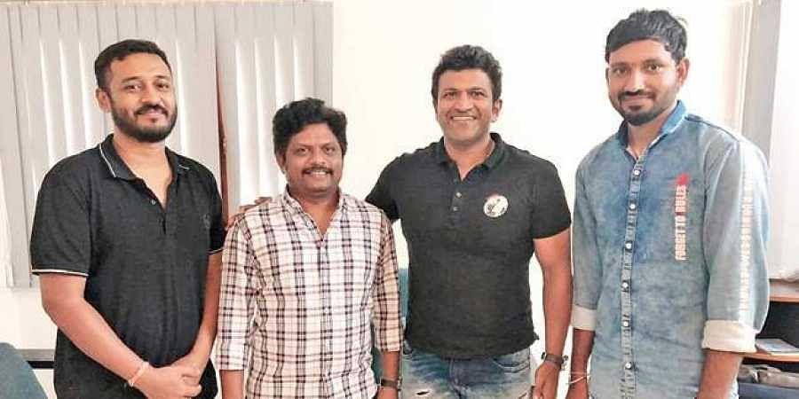 Charan Raj along with the actor, Kishore Pathikonda, and Chethan Kumar