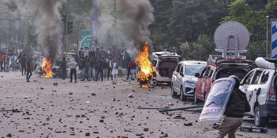 Police personnel clash with protestors during a rally against NRC and amended Citizenship Act that turned violent at Parivartan Chowk in Lucknow Thursday Dec. 19 2019. (Photo | PTI)