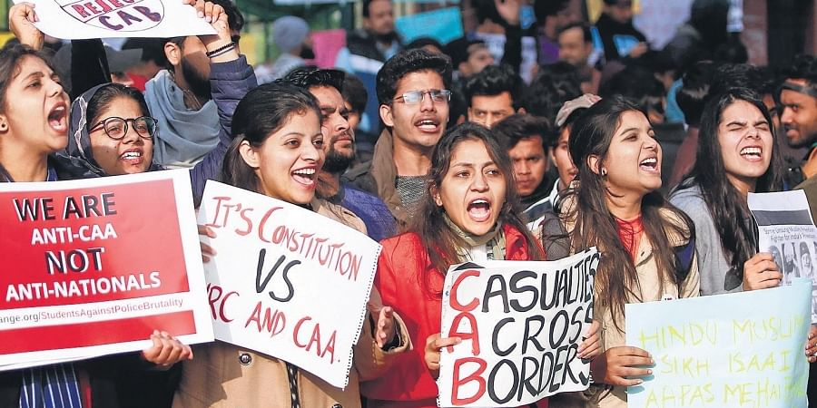 Protesters, including students and local residents, hold placards during a demonstration against the CAA outside Jamia in New Delhi.