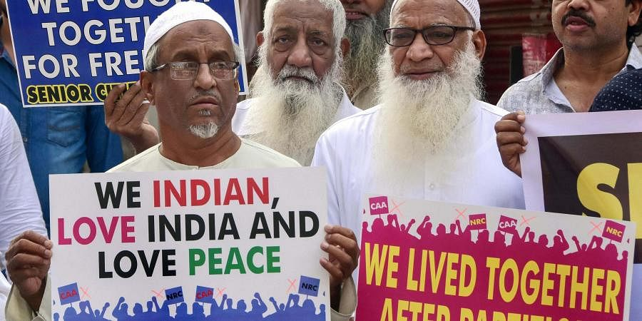 Members of Muslim community hold placards during a protest against the Citizenship Amendment Act CAA and NRC at Agripada in Mumbai Friday Dec. 20 2019.