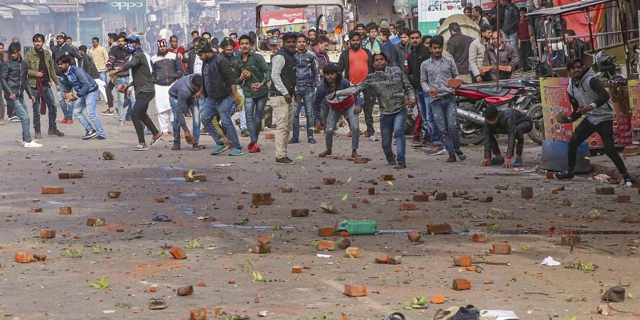 Protestors pelt stones at police personnel after their clash during a rally against NRC and amended Citizenship Act in Lucknow Thursday Dec. 19 2019. (Photo | PTI)