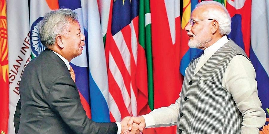 Prime Minister Narendra Modi greets Asian Infrastructure Investment Bank chief Jin Liqun at the third annual meeting of AIIB Forum in Mumbai on Tuesday.