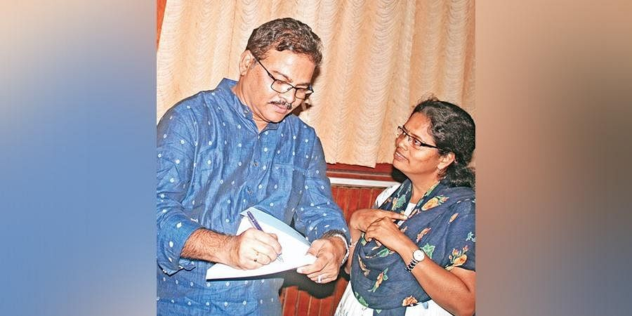 Poet Afsar Muhammad obliges a fan after he launched his book  'Afsar Kavitvam',  an anthology of poems, at Salar Jung Museum on Friday