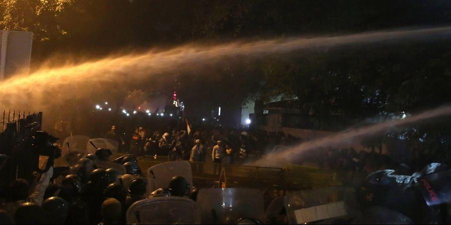 Delhi police use water canon during demonstration against Citizenship Amendment Act at Dariya Ganj in New Delhi on Friday. (Photo | Shekhar Yadav/EPS)