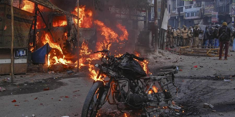 A vehicle torched allegedly by protestors during a demonstration against the Citizenship Amendment Act CAA in Kanpur Saturday Dec.21 2019.