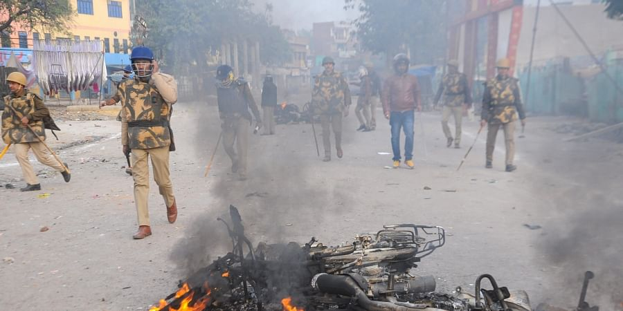 Smoke billows out of a charred vehicle as a protest against the Citizenship Amendment Act turned violent at Babu Purwa in Kanpur Friday Dec. 20 2019. (Photo | PTI)