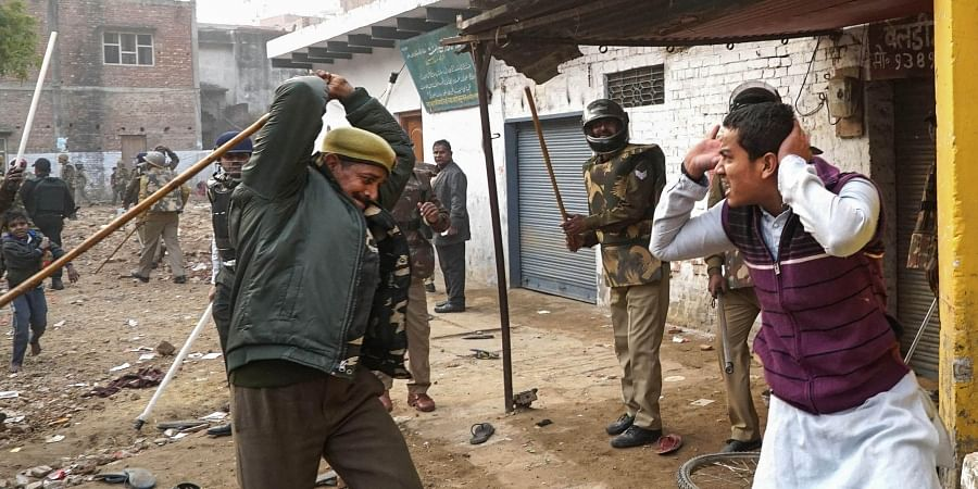 Police personnel baton charge protestors demonstrating against the Citizenship Amendment Act in Varanasi Friday Dec. 20 2019