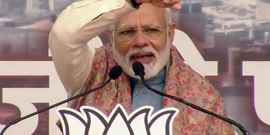 Prime Minister Narendra Modi addresses a BJP rally at Ramlia Maidan, in New Delhi on Sunday.