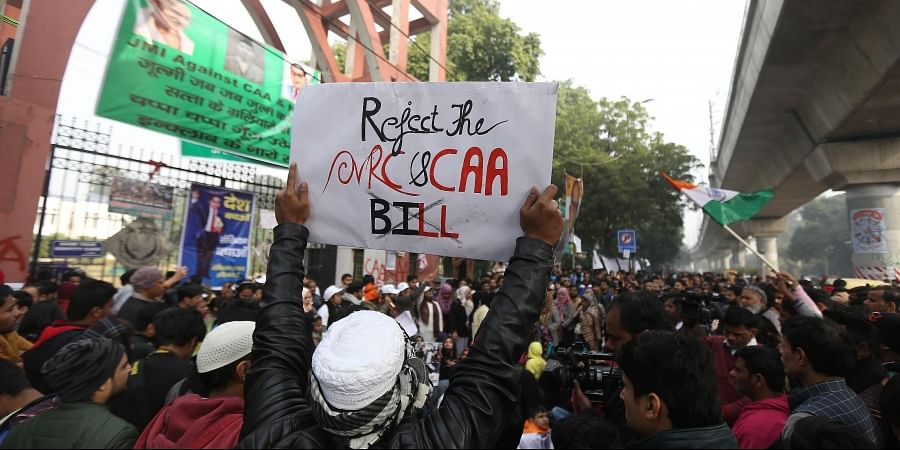 Protestors including students and local residents during a demonstration against the Citizenship Amendment Act CAA outside Jamia Millia Islamia University in New Delhi on Saturday.  (Photo | Arun Kumar P/EPS)