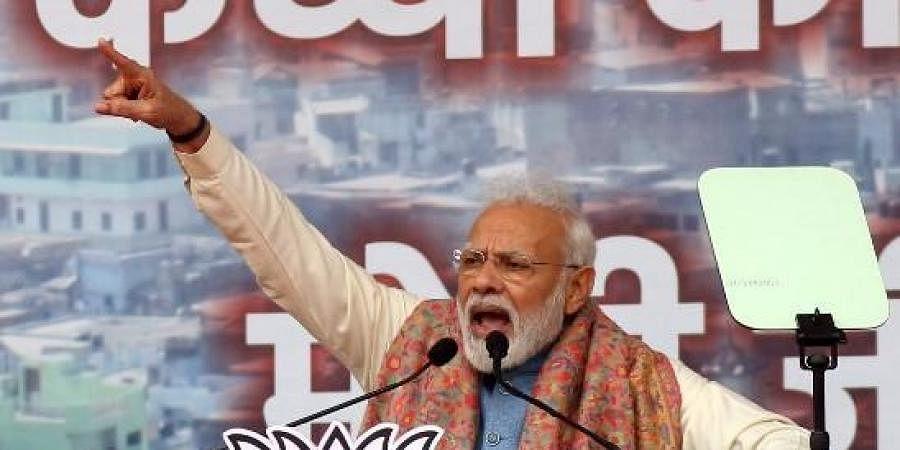 Prime Minister Narendra Modi addresses a BJP rally at Ramlia Maidan, in New Delhi on Sunday