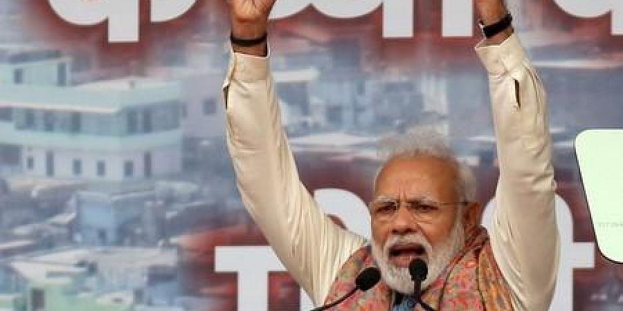 Prime Minister Narendra Modi addresses a BJP rally at Ramlila Maidan, in New Delhi on Sunday