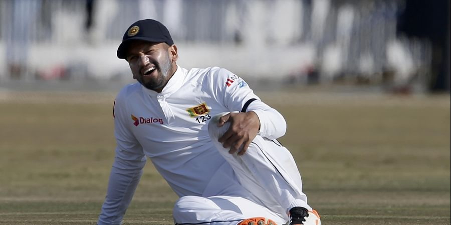 Sri Lankan skipper Dimuth Karunaratne reacts after a ball hit on his knee during the fifth day of the first cricket test match between Pakistan and Sri Lanka. (Photo | AP)