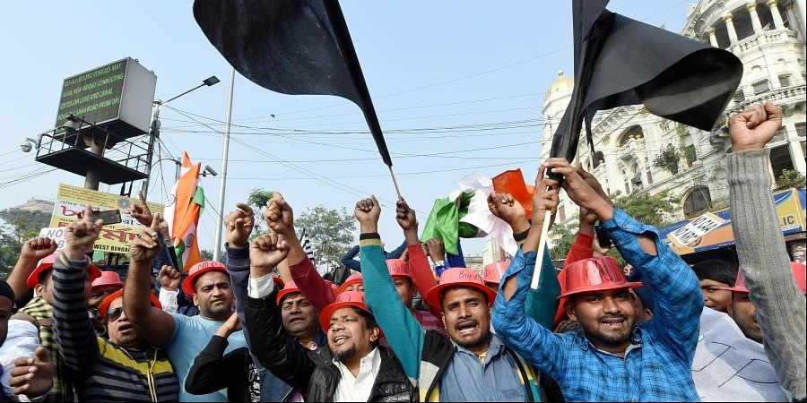 Protestors hold placards and raise slogans during a demonstration against the Citizenship Amendment Act and NRC in Kolkata Sunday Dec. 22 2019. (Photo | PTI)