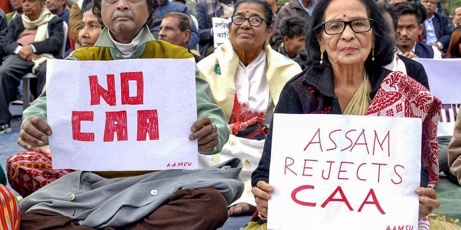 Senior citizens display placards during a protest against the Citizenship (Amendment) Act at Latashil Playground in Guwahati