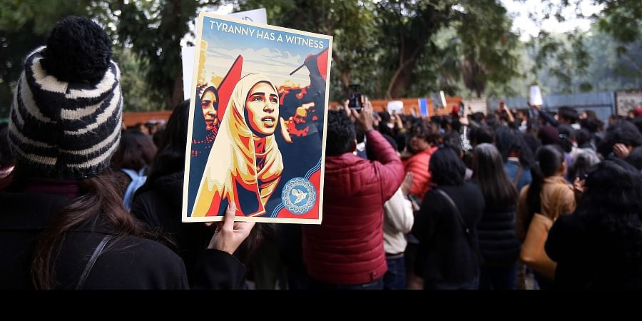 Demonstrators gather during a protest against a new citizenship bill at Jantar Mantar in New Delhi on Sunday.