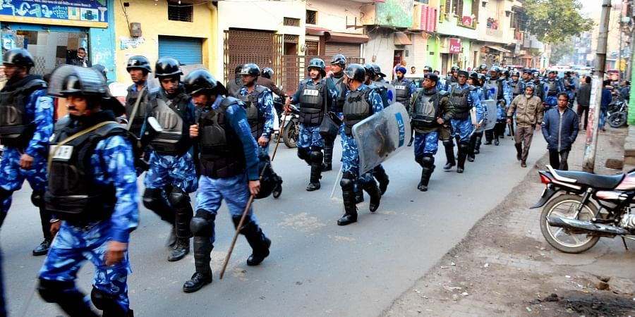 Rapid Action Force (RAF) personnel patrol a street following protests against the recently enacted Citizenship Amendment Act in several areas Moradabad Sunday Dec. 22 2019. (Photo | PTI)