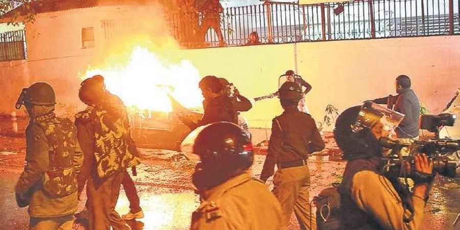 Police and media personnel outside the DCP Central's office in Daryaganj where protesters set ablaze a car on Friday evening.